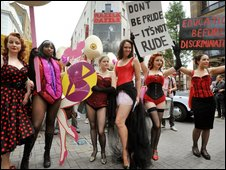 burlesque dancers march on town hall