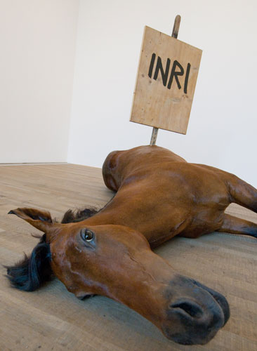 Maurizio Cattelan's Untitled dead horse with a stick in it