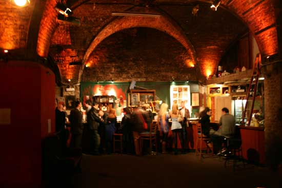 A bar in one of many cavernous rooms.